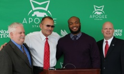 2013 Armed Forces Merit Award winner Brandon McCoy of North Texas (second from right) is pictured with (left to right) FWAA Executive Director Steve Richardson, North Texas coach Dan McCarney and Brant Ringler, executive director of the Bell Helicopter Armed Forces Bowl.