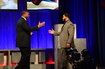 Aaron Donald (right), the 2013 Outland Trophy winner, is congratulated by Chris Samuels, the 1999 Outland Trophy winner. Photo courtesy of ESPN.