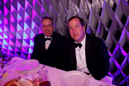 2013 FWAA President Chris Dufresne joins Tyler Hale, vice president of studio productions at CBS Sports, on the dais at the 2013 National Football Foundation Dinner at the Waldorf in New York last December. (Photo Courtesy of NFF)