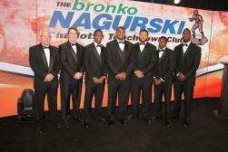 Bronko Nagurksi Award: left to right: Randy Rhino of Georgia Tech, Bronko Nagurski Legends Winner, Florida coach Will Muschamp, and the five 2013 Bronko Nagurski finalists; Darqueze Dennard of Michigan State, Michael Sam of Missouri, Aaron Donald of Pittsburgh, Lamarcus Joyner of Florida State and C.J. Mosley of Alabama. Photo by Ron J.Deshaies/Treasured Events of Charlotte.