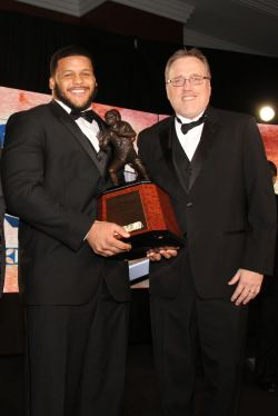 FWAA President Chris Dufresne (right) presents the 2013 Bronko Nagurski Award to Aaron Donald of Pittsburgh in Charlotte, N.C. on Dec. 9. Photo by Ron J.Deshaies/Treasured Events of Charlotte.
