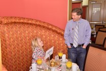 Jon Wilner, San Jose Mercury News sports writer, interacted with his daughter Anna before receiving the FWAA's 2013 Beat Writer of the Year Award at the 2014 FWAA Annual Awards Breakfast. (Photo courtesy of Rose Bowl)