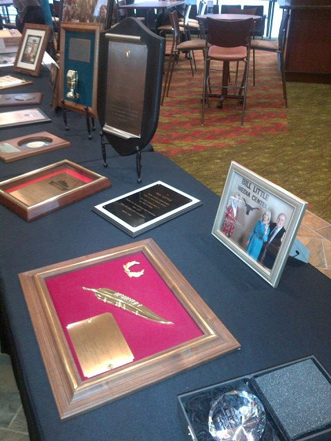 Several of Bill Little's awards were displayed at the reception on Aug. 28.