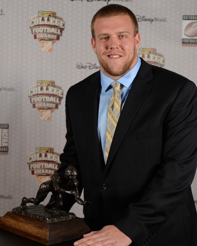 Brandon Scherff of Iowa with his 2014 Outland Trophy.