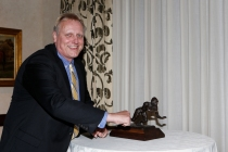 Past President Ron Higgins with the Outland Trophy.