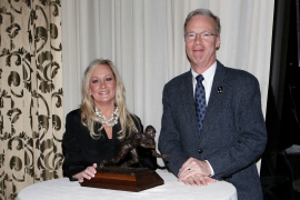Margaret Mason and Malcolm Moran with the Outland Trophy.