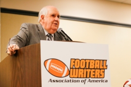 Former Texas SID Bill Little addresses the membership. Photo by Melissa Macatee.