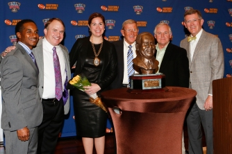 Eddie Robinson III, FWAA Coach of the Year Gary Patterson of TCU, Patterson's wife, Kelsey, former Notre Dame Coach Lou Holtz, FWAA 2014 President Kirk Bohls and Allstate Sugar Bowl President Judge Dennis Waldron.