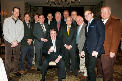 Left to right, Ivan Maisel, Blair Kerkhoff, Dick Weiss, Tony Barnhart, George Schroeder, Mark Blaudschun, Ron Higgins, Tim Griffin, Chris Dufresne, Kirk Bohls, Dennis Dodd, Tom Shatel with National Football Foundation President and CEO Steve Hatchell, seated. (Melissa Macatee photo)