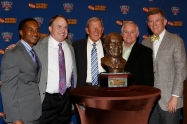 Eddie Robinson III, TCU Coach Gary Patterson, former Notre Dame Coach Lou Holtz, 2014 FWAA President Kirk Bohls and Sugar Bowl President Judge Dennis Waldron pose with the FWAA Eddie Robinson Coach of the Year Trophy. Patterson received the award on Jan. 10, 2015, in Dallas.