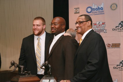 2014 Outland Trophy winner Brandon Scherff of Iowa (left), 1992 winner Will Shields of Nebraska (center) and 1976 winner Ross Browner of Notre Dame at the Outland Trophy presentation banquet on Jan. 15, 2015, at the Doubletree Hotel in Omaha.