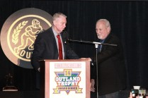 Former Nebraska Coach Tom Osborne presents the first Tom Osborne Legacy Award for contributions to line play to his long time assistant, offensive line coach Milt Tenopir. The presentation occurred during the Outland Trophy banquet on Jan. 15 in Omaha.