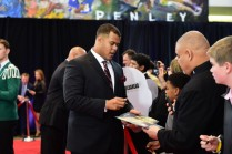 2015 Outland Trophy winner Joshua Garnett of Stanford signs autographs along the red carpet at the College Football Awards Show. (Photo by Phil Ellsworth / ESPN Images)