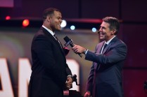 Chris Fowler of ESPN interviews Outland Trophy winner Joshua Garnett of Stanford during the College Football Awards Show. (Photo by Phil Ellsworth / ESPN Images)