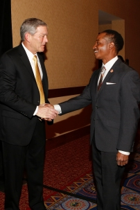 Iowa Coach Kirk Ferentz, winner of the Eddie Robinson Coach of the Year Award, shakes hands with Eddie Robinson III, grandson of the award's namesake, at a reception on Jan. 9 in Scottsdale, Ariz. Photo by Melissa Macatee.