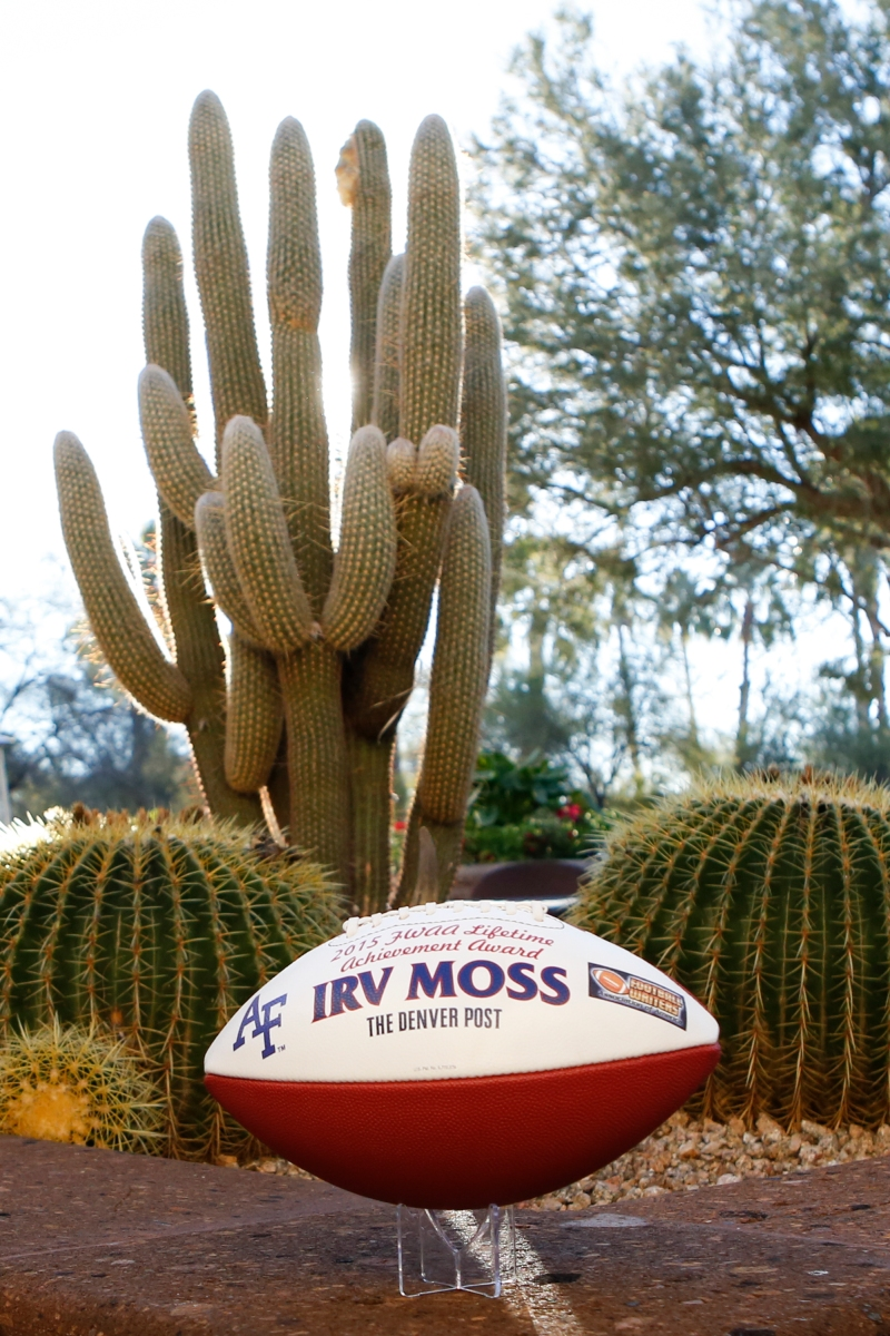 Irv Moss of the Denver Post received this commemorative football in recognition of his Lifetime Achievement Award. Photo by Melissa Macatee.