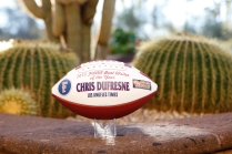 Chris Dufresne, who recently retired from the Los Angeles Times, received this commemorative football as the 2015 FWAA Beat Writer of the Year. Photo by Melissa Macatee.