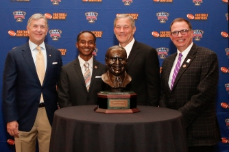 From left: Sugar Bowl President Carey Wicker, Eddie Robinson III, Iowa Coach Kirk Ferentz and 2015 FWAA President Lee Barfknecht at a reception honoring Ferentz as the winner of the Eddie Robinson Coach of the Year Award. Photo by Melissa Macatee.