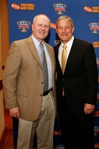 Sugar Bowl COO Jeff Hundley and Iowa coach Kirk Coach Ferentz at the Eddie Robinson Coach of the Year reception on Jan. 9 in Scottsdale, Ariz. Photo by Melissa Macatee.