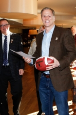 Ted Miller of ESPN.com accepted a commemorative football and certificate for first place in the column category of the FWAA's 2015 Best Writing Contest. Photo by Melissa Macatee.