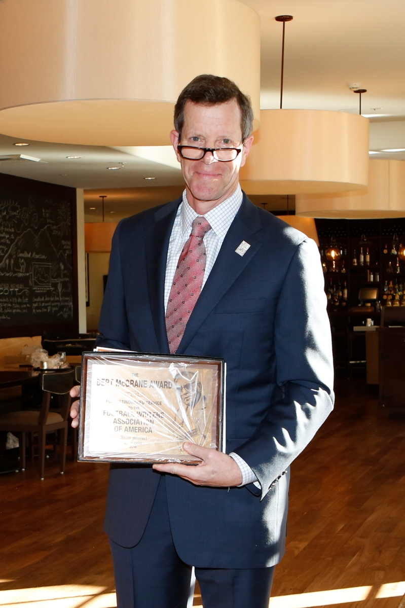 Ivan Maisel of ESPN.com holds his Bert McGrane Award. Photo by Melissa Macatee.