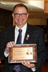 Lee Barfknecht accepts the Outgoing President's Plaque at the FWAA's annual Awards Breakfast no Jan. 11, 2016, in Scottsdale, Ariz. Photo by Melissa Macatee.