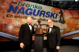 Temple linebacker Tyler Matakevich, winner of the 2015 Bronko Nagurski Trophy, with FWAA 2015 president Lee Barfknecht. Photo by Ron J.Deshaies/Treasured Events of Charlotte.