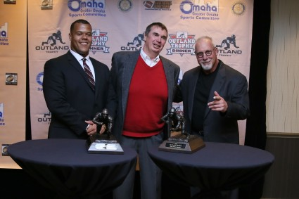 Three Outland Trophy winners: Joshua Garnett of Stanford (2015), Larry Jacobson of Nebraska (1971) and Randy White of Maryland (1974). Photo provided by the Greater Omaha Sports Committee.