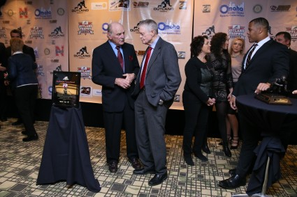 Former Nebraska Coach Tom Osborne talks with Jim Ridlon Sr., the sculptor who created the Outland Trophy and the recipient of this year's Tom Osborne Legacy Award, sponsored by the Rotary Club of Omaha-Downtown. Photo provided by the Greater Omaha Sports Committee.