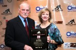 Jim Ridlon Sr., the sculptor of the Outland Trophy, and his wife pose with the Tom Osborne Legacy Award. Photo provided by the Greater Omaha Sports Committee.