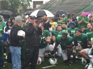 Marshall Coach Doc Holliday and the Herd football team showed their appreciation to Jack Bogaczyk for his coverage on a rainy April Saturday to cap 2016 spring practice.