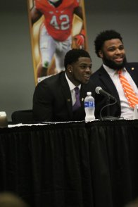 Jabrill Peppers of Michigan (left) and Christian Wilkins of Clemson, two of the five finalists for the 2016 Bronko Nagurski Trophy, enjoy a light moment during a leadership forum with high school students preceding the award banquet. (Photo by Michael Strauss, Strauss Studios.)