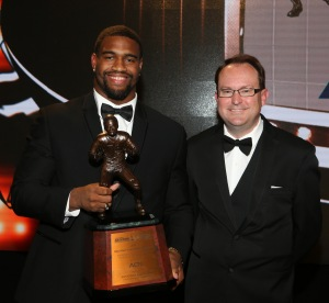 Alabama defensive end Jonathan Allen, winner of the 2016 Bronko Nagurski Trophy, poses with 2016 FWAA President Mark Anderson.