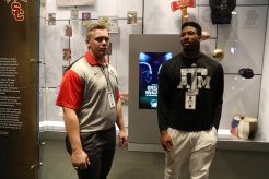 Two members of the 2016 FWAA All-America first team, Pat Elflein of Ohio State (left) and Myles Garrett of Texas A&M, browse among the exhibits at the College Football Hall of Fame in Atlanta. (Photo by Allen Kee / ESPN Images)