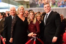 Outland Trophy finalist Pat Elflein of Ohio State poses with his family on the red carpet at the Home Depot College Football Awards Show at the NFF College Football Hall of Fame in Atlanta. (Photo by Phil Ellsworth / ESPN Images)