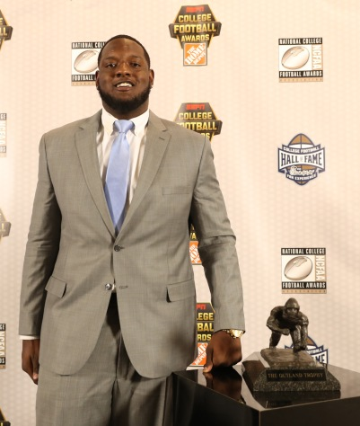 Cam Robinson of Alabama poses with his Outland Trophy. (Photo by Allen Kee / ESPN Images)