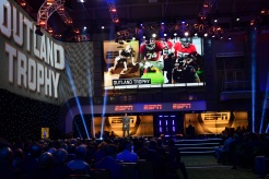 The Outland Trophy makes a splash on the big screen at the Home Depot College Football Awards Show at the National Football Foundation College Football Hall of Fame in Atlanta. (Photo by Phil Ellsworth / ESPN Images)