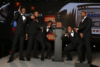 The five finalists for the 2016 Bronko Nagurski Trophy ham it up on stage. (Photo by Michael Strauss, Strauss Studios.)