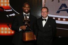 2016 Bronko Nagurski Trophy winner Jonathan Allen with FWAA President Mark Anderson. (Photo by Michael Strauss, Strauss Studios.)