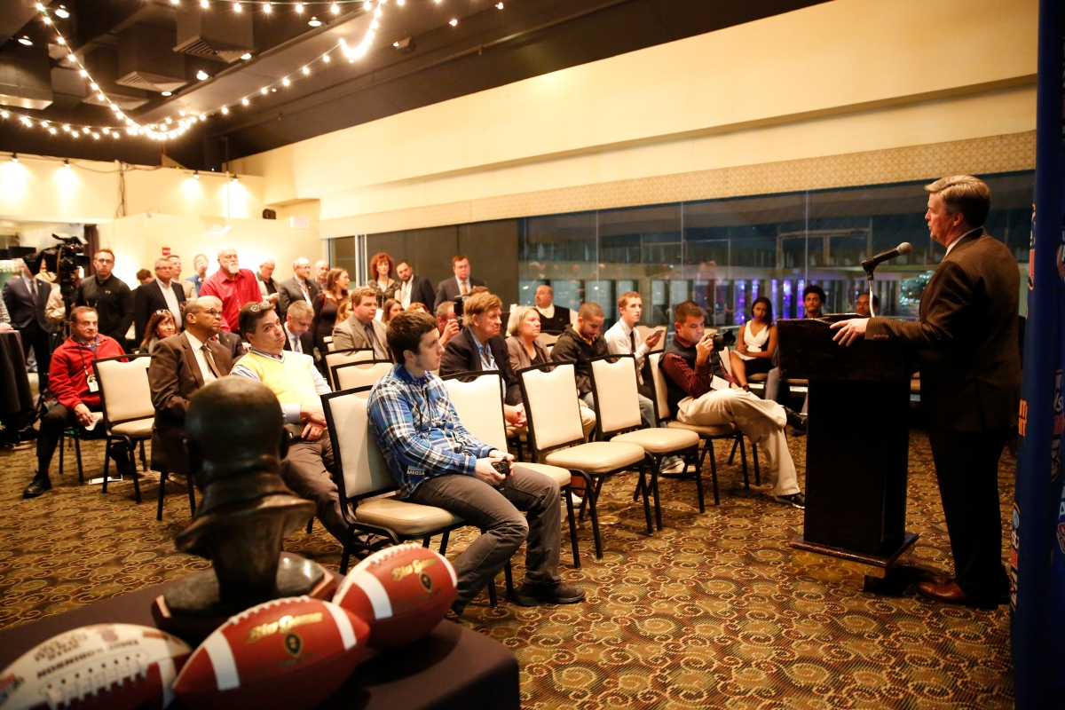 Colorado Coach Mike MacIntyre, winner of the FWAA Eddie Robinson Coach of the Year Trophy, addresses FWAA members and guests on Jan. 7, 2017, in Tampa. Photo by Melissa Macatee.