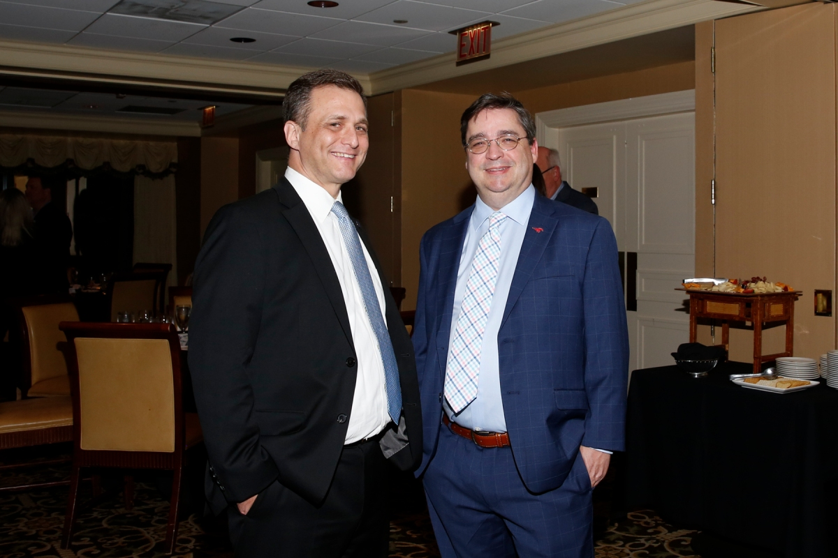 Phil Marwill of the National Football Foundation and Ted Gangi of collegepressbox.com were guests at the FWAA's Past Presidents Dinner on Jan. 6, 2017, in Tampa. Photo by Melissa Macatee.