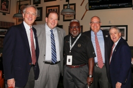 Gathered at the FWAA's Awards Breakfast on Jan. 9, 2017, in Tampa are, from left, Rick Baker, president and CEO of the Cotton Bowl, Michael Konradi of the Cotton Bowl staff, Alfred White of the College Football Playoff staff, Jay McAuley, chairman of the Cotton Bowl Athletic Association, and Fin Ewing III, past chairman of the Cotton Bowl. Photo by Melissa Macatee.