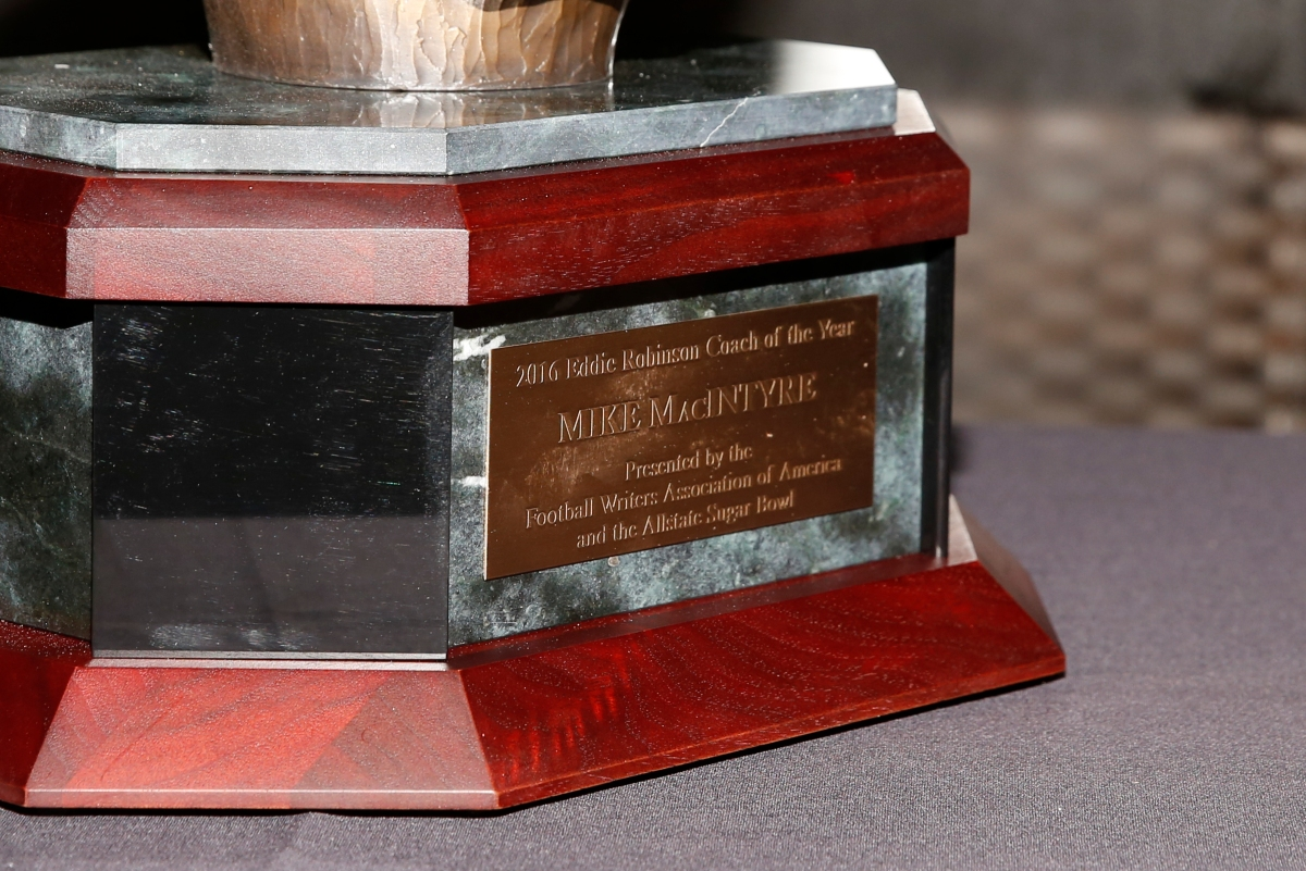 The base of the FWAA Eddie Robinson Coach of the Year Award, bearing the name of the 2016 winner, Colorado Coach Mike MacIntyre. Photo by Melissa Macatee.