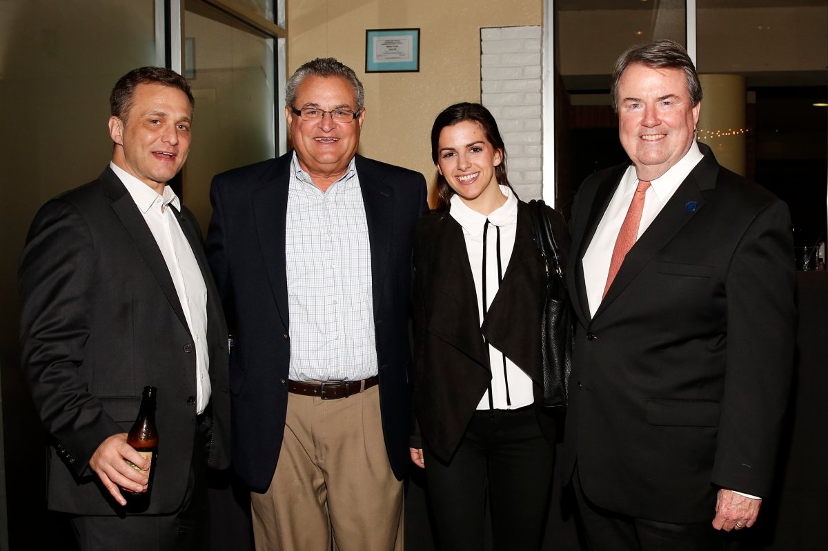 National Football Foundation president and CEO Steve Hatchell (far right) is joined by (left to right) Phillip Marwill of the NFF, Larry Wahl of the Orange Bowl and McBride Macatee at the Eddie Robinson Coach of the Year reception. Photo by Melissa Macatee.