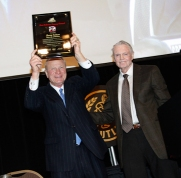 Former Oklahoma Coach Barry Switzer, with former Nebraska Coach Tom Osborne, hoists his Tom Osborne Legacy Award during the Outland Trophy Presentation Banquet on Jan. 11, 2017, in Omaha. Photo by C41 Photography.