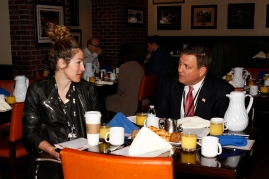Keri Potts of ESPN, which sponsored the FWAA Awards Breakfast, chats with former FWAA president Mike Griffith on Jan. 9, 2017, in Tampa. Photo by Melissa Macatee.
