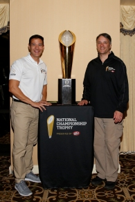 Trophy handlers Ray Mallouk (left) and Charley Green brought the national championship trophy to the FWAA Past Presidents Dinner on Jan. 6, 2017, in Tampa. Photo by Melissa Macatee.