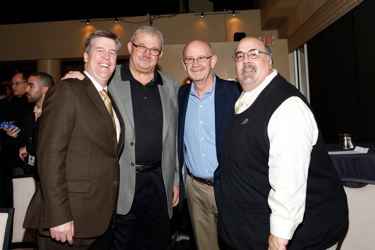 Colorado Coach Mike MacIntyre, Tim Simmons of the Armed Forces Bowl, Doug Vance of CoSIDA and Colorado SID Dave Plati at the Eddie Robinson Coach of the Year Reception on Jan. 7, 2017, in Tampa. Photo by Melissa Macatee.
