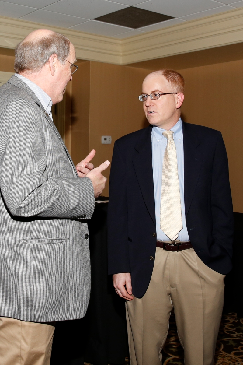 College Football Playoff Executive Director Bill Hancock chats with Jon Solomon, who will be second vice president of the FWAA in 2017, at the FWAA's Past Presidents Dinner on Jan. 6, 2017, in Tampa.  Photo by Melissa Macatee.