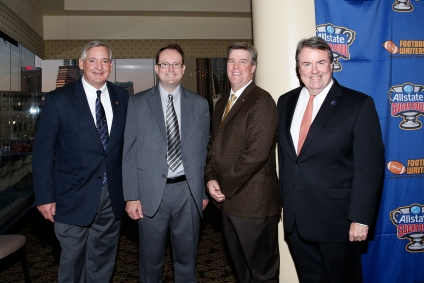 Chuck Lapeyre of the Sugar Bowl, FWAA 2016 President Mark Anderson, Colorado Coach Mike MacIntyre and Steve Hatchell, president and CEO of the National Football Foundation at the Eddie Robinson Coach of the Year Reception on Jan. 7, 2017, in Tampa. Photo by Melissa Macatee.